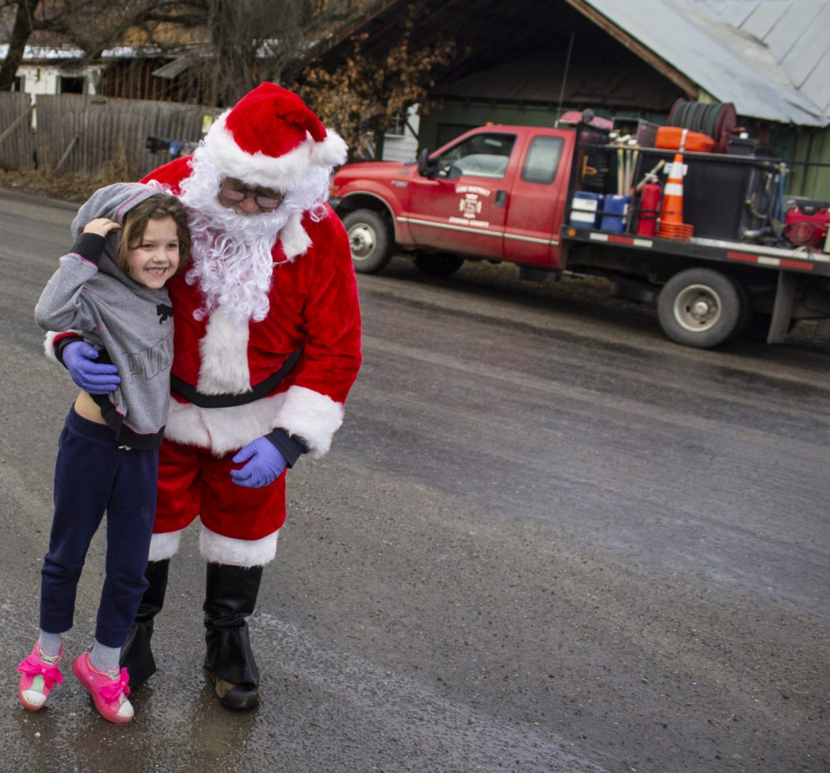 IN PHOTOS: Santa comes over in a fire truck