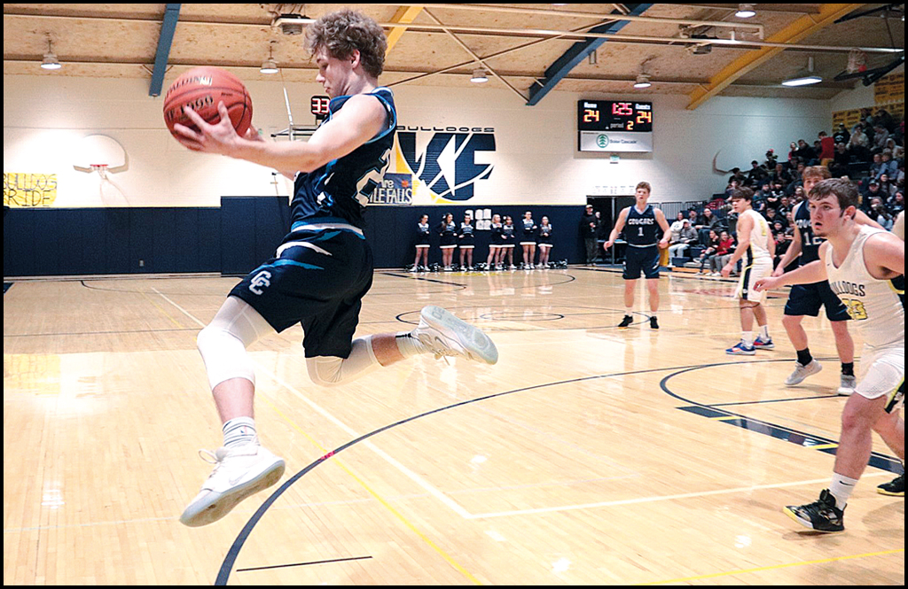 BOYS BASKETBALL: Cougs drop games to league powers